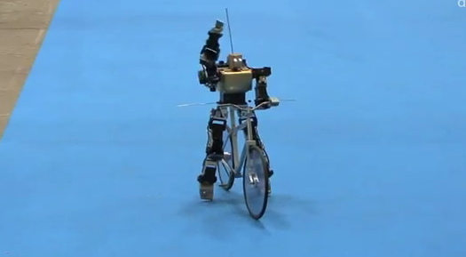 Robot riding a bike.